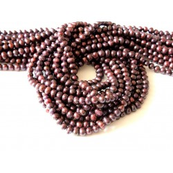 Strand of garnet color pearls
